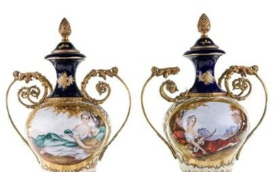 blue and white, decorated in gold with ornamental motifs, in the center two medallions painted with allegorical figures, base and seals in gilded bronze h 47 cm