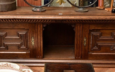 A 19TH CENTURY FRENCH CARVED OAK DESK CABINET, 157 CM LONG