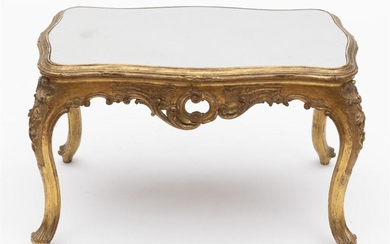 A 19TH CENTURY LOUIS XV STYLE GILTWOOD OCCASIONAL TABLE OF SERPENTINE FORM WITH A MIRROR TOP. 46CM H X 74CM W X 47CM D.