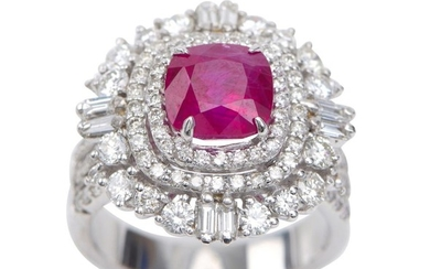 A BURMESE RUBY AND DIAMOND CLUSTER RING - Featuring a cushion cut ruby weighing 3.12cts, with diamonds to the surround and shoulders...