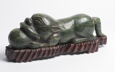 A CHINESE SPINACH JADE GUARDIAN LION 20TH CENTURY