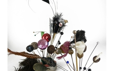 A COLLECTION OF EARLY 20TH CENTURY HATPINS Comprising a Chin...
