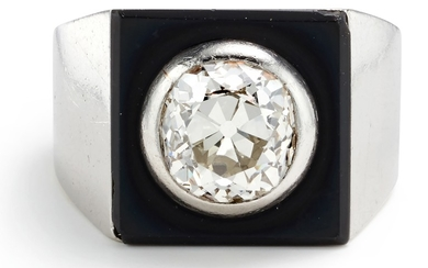 A Diamond, Onyx and Gold Ring