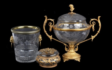 A French engraved clear glass and gilt metal mounted twin-handled pedestal punch bowl and cover