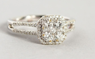 A GOOD 18CT WHITE GOLD DIAMOND AND CLUSTER DRESS RING.
