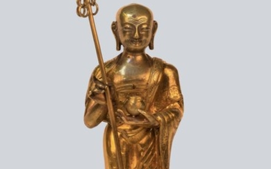 A Gilt Bronze Figurine of Bodhisattva Ksitigarbha, China, 18th Century.