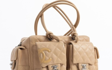 A HANDBAG BY CHANEL Styled in beige quilted leather with silver metal hardware, 16 x 34 x 14cm.
