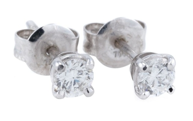 A PAIR OF SOLITAIRE DIAMOND STUD EARRINGS; each set with a round brilliant cut diamond in 18ct white gold, 2 diamonds total approx....