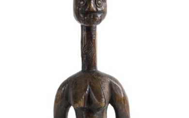 A WOODEN STANDING FEMALE FIGURE