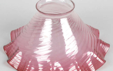 A cranberry glass oil lamp shade of frilled form, together with two wall hanging mirrors, etc.