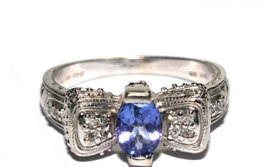 A diamond and tanzanite white gold ring set in 14 carat gold