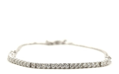 SOLD. A diamond bracelet set with numerous brilliant-cut diamonds, totalling app. 0.90 ct. mounted in...