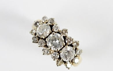 A diamond cluster ring, comprising a central round brilliant...