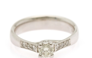 A diamond ring set with a brilliant-cut diamond weighing app. 0.30 ct. flanked by six diamonds, mounted in 14k white gold. Size 54.