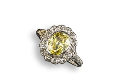 A fancy diamond cluster ring, centred with an...