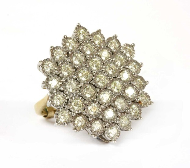 A gold diamond cluster ring