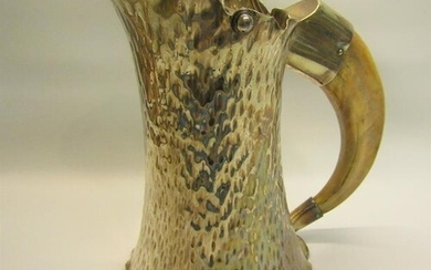A late Victorian silver plated ale jug of beaten tapering sp...