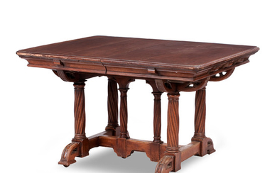 A mid 19th century walnut Reformed Gothic dining table