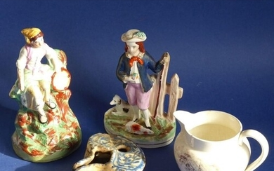 A mixed pottery group to include two mid-19th century Staffo...