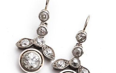 A pair of Belle Èpoque diamond ear pendants each set with a brilliant-cut diamonds encirled by numerous old-cut diamonds weighing a total of app. 4.12 ct. (2)