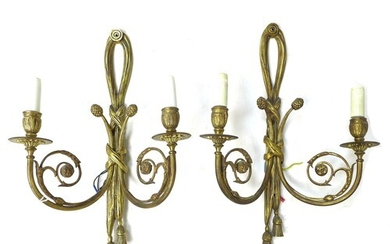 A pair of French gilt metal wall sconces, twin branch with s...
