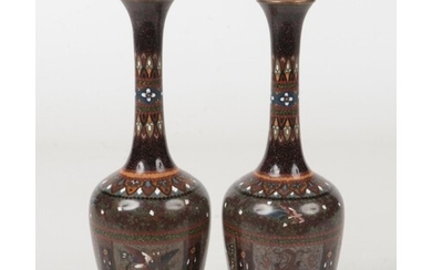 A pair of Japanese Meiji period cloisonne bottle vases. Blac...