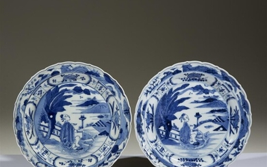 A pair of Japanese blue and white porcelain barbed...