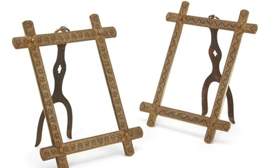 A pair of koftgari steel picture frames,...
