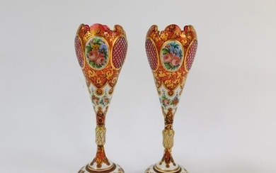 A pair of late 19thC Bohemian flashed cranberry glass vases,...