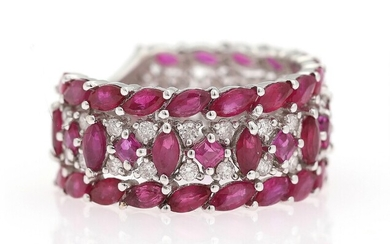 A ruby- and diamond ring set with numerous rubies and diamonds, mounted in 18k white...