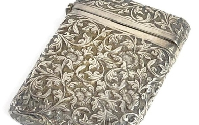 A silver coloured metal card case, with embossed and...