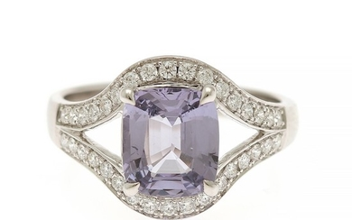 A spinel and diamond ring set with a cushion-cut lavender spinel, app. 2.05 ct., and numerous brilliant-cut diamonds, mounted in 18k white gold. Size 53.