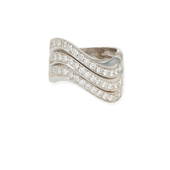 A white gold and diamond wave ring