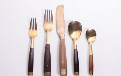 A wood and brass cutlery set