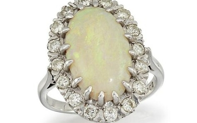 AN OPAL AND DIAMOND CLUSTER RING The oval cabochon