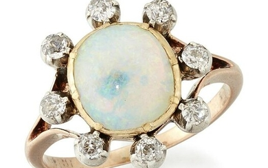 AN OPAL AND DIAMOND CLUSTER RING, an oval opal in a