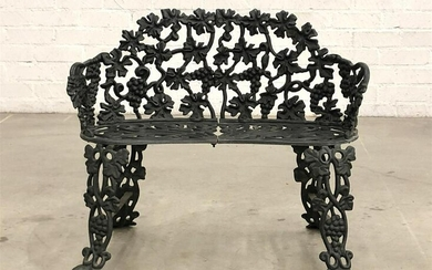 An English black painted cast iron garden bench