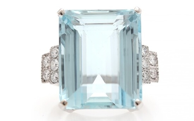 An aquamarine and diamond ring set with an emerald-cut aquamarine weighing app. 30.65 ct. flanked by ten diamonds, mounted in 18k white gold. Size 55.
