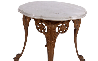 An iron cast low table with marble top