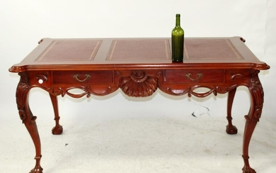 Carved mahogany bureauplat desk with shell