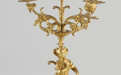 Heavy fire-gilt bronze candlestick with a woman.&#160