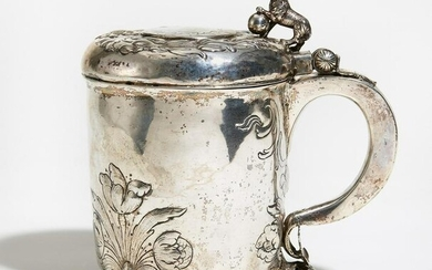 Large silver tankard with gilt interior and ball feet