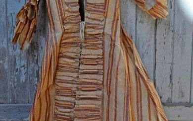 """On silk dress in the 18th century style, in beige and brown tones, label bearing the words: """"Catherine de Bruguière, 1789""""."""