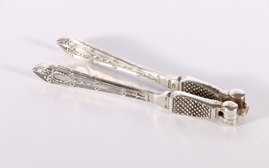 Pair of George V silver nut cracks with Adams inspired handl...