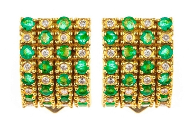 Pair of gold ear clips set with emeralds and brilliants. Gross weight: 10.1 g