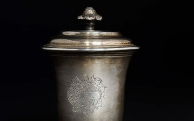 Plain silver blush pot stamped with a wedding coat of arms surmounted by a helmet resting on a pedestal, the neck threaded. The lid with a doucine and the leafy socket. MONTPELLIER 1755 (letter D) Master goldsmith: Marc BAZILLE received Master in 1732...