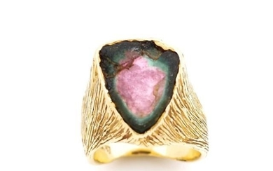Rough cut gemstone and 18ct yellow gold ring tests as waterm...