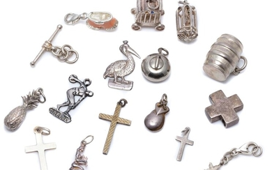 SIXTEEN SILVER CHARMS/PENDANTS; including a curling ball, wine barrel, a carriage, caged bird, a pelican, a Discobolus of Myron, a p...