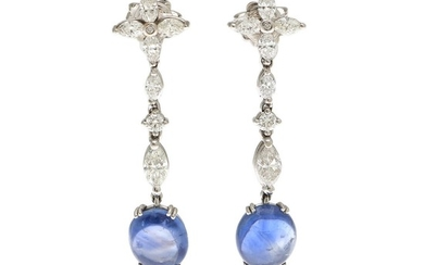 Sapphire and diamond ear pendants each set with a cabochon sapphire and numerous marquise-cut and brilliant-cut diamonds, mounted in 18k white gold. L. 4 cm. (2