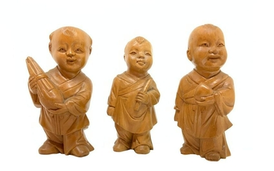 Sculptures of three Chinese children in maple wood